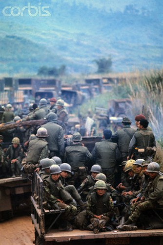 07 Feb 1971, Near Khe Sanh, South Vietnam --- American and Vietnamese soldiers travel in personnel carriers during Operation Dewey Canyon II/Lam Son 719, which is aimed to reopen and secure Route 9 and reoccupy Khe Sanh as a forward supply base. --- Image by © Bettmann/CORBIS