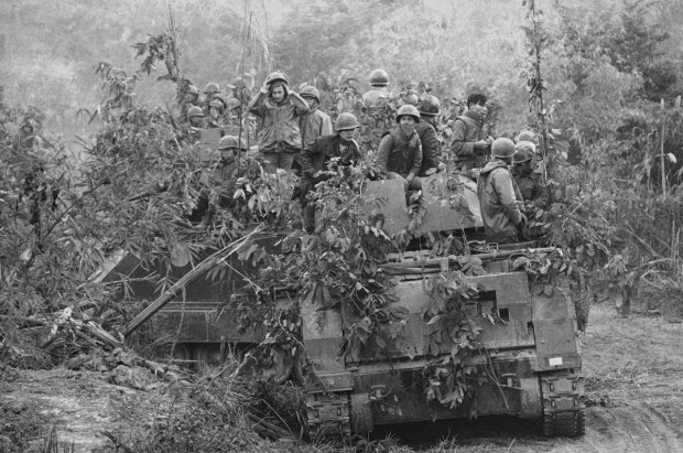 South Vietnamese armored personnel carrier, loaded with airborne troops, moves along Route 9 at Lang Vei, south Vietnam on Feb. 1971