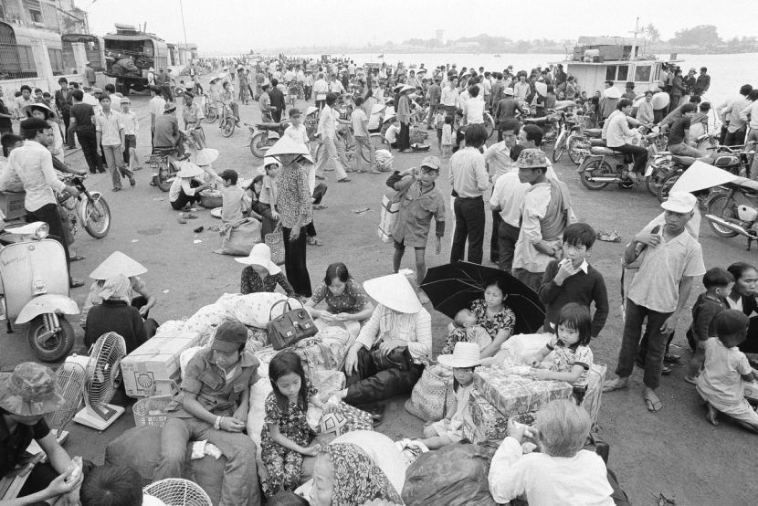 Nowhere to go and nothing to do, South Vietnamese refugees from Hue and the northern provinces pause on the dock waiting for the government to relocate them to the central coastal area at Da Nang in Vietnam, March 28, 1975. (AP Photo/Phuoc)