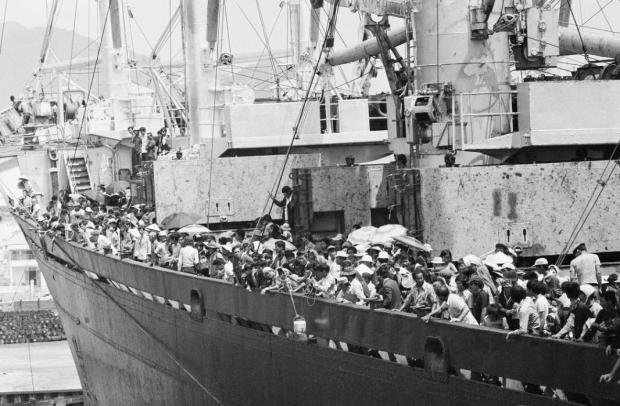 Teeming frightened humanity crowds the decks of the merchant vassal Pioneer Contender as it docks at Cam Ranh Bay on the central coast of South Vietnam, Friday, March 29, 1975. Ship carried 5,600 South Vietnamese refugees and about 40 Americans out of Danang, a refugee crammed city under the gun. (AP Photo/Huynh Cong/Ut)